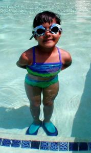 girl in sunglasses standing in pool MorgueFile